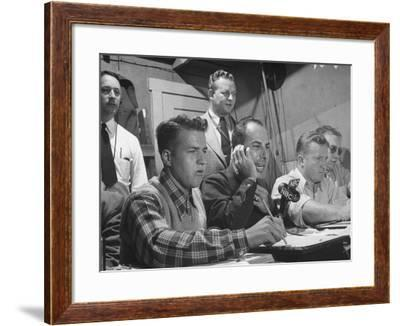 Sports Commentator William Stern Performing a Broadcast During a Football Game--Framed Photographic Print