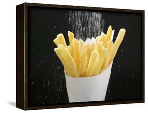 Sprinkling Salt over Chips