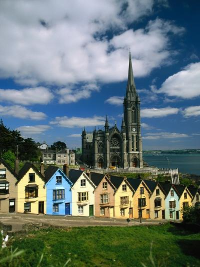 St. Coleman's Cathedral of Cobh Behind Colorful Row Houses-Charles O'Rear-Photographic Print