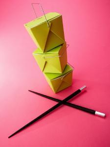 Stack of Chinese Food Takeout Boxes with Chopsticks