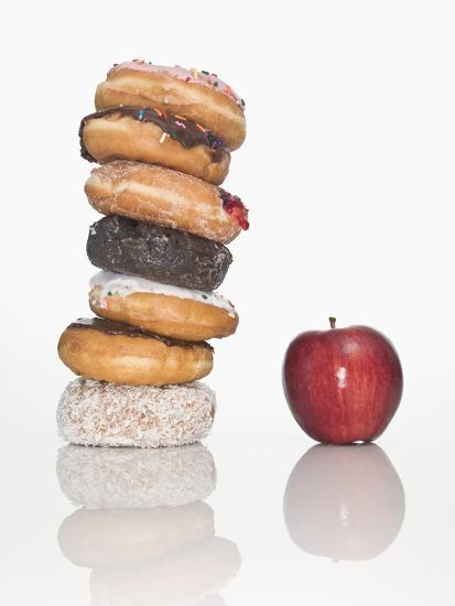 Stack of Donuts and One Apple--Photographic Print