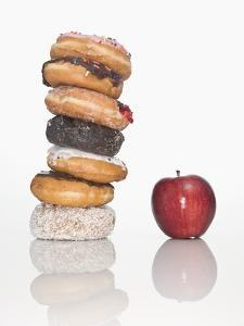Stack of Donuts and One Apple