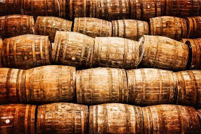 Stacked Pile of Old Vintage Whisky and Wine Wooden Barrels-MartinM303-Photographic Print