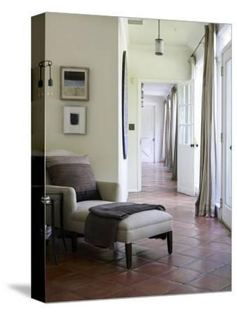 Armchair and Footstool in Terracotta Tiled Hallway