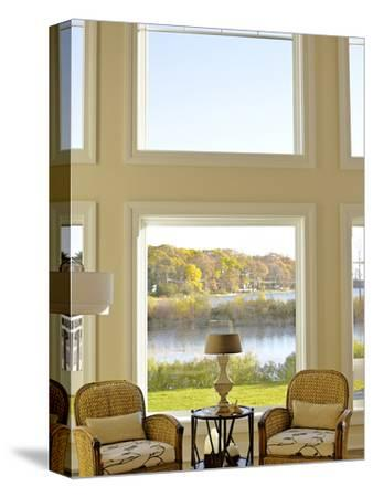 Armchairs Either Side of Round Table with View to Bay, Usa