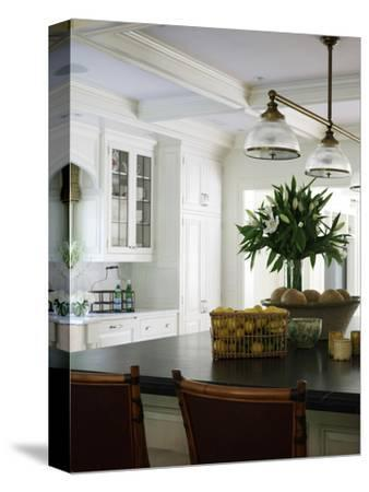 Breakfast Bar with Baskets of Fruit and Cut Flowers in Shelley Morris Designed Colonial Style Resid
