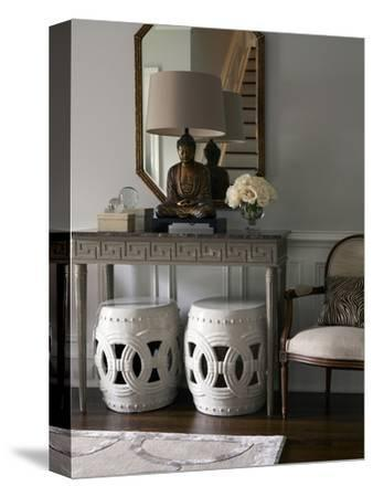 Buddha Statue on Console Table with Stools in Hallway