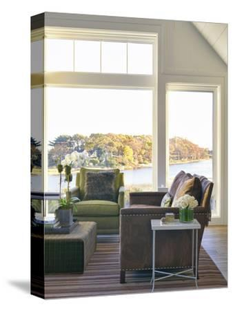 Seating around Coffee Table in Living Room with View to Bay, Usa