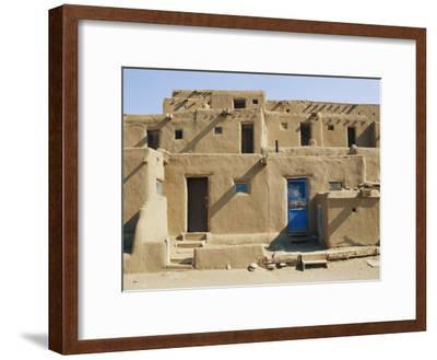 Bright Sunshine Casts Harsh Shadows on This Southwestern Adobe Pueblo Structure