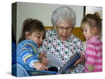 Great Grandmother Reads to Her Great Grandchildren