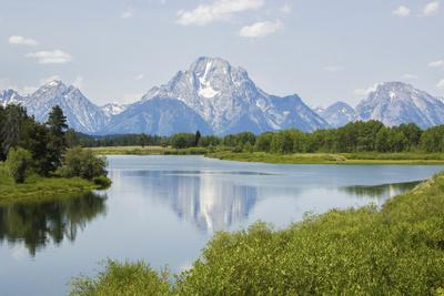 Scenic View of a Lake Underneath the Peaks of the Grand Teton Mountains
