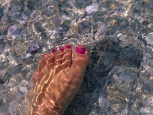 Woman's Foot in the Warm Water of the Gulf of Mexico, Holmes Beach, Florida by Stacy Gold