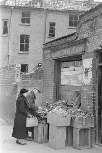 Bombed out Greengrocer's store. 26th April 1941 by Staff