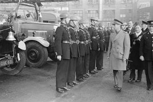 King George VI inspects firemen on his visit to Birmingham during WW2 by Staff