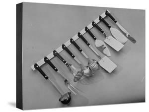 Stainless Steel Kitchen Utensils Hanging on a Rack
