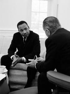 Civil Right Leader Dr. Martin Luther King Speaking with President Lyndon Johnson by Stan Wayman