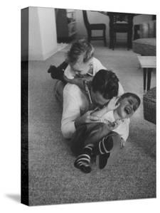 Mike Sibole, Four-Year-Old Recently Blinded to Save His Life, Playing with Father and Brother by Stan Wayman