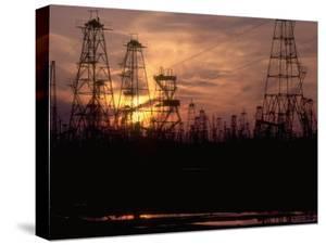 Oil Derricks at Sunset at Baku, Azerbaijan, Ussr by Stan Wayman