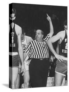 Referee Jim Enright Calling Plays and Using Hand Signals During a Game by Stan Wayman