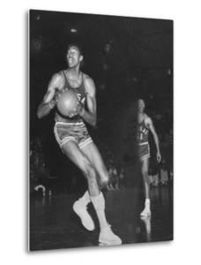 Wilt Chamberlain Playing Basketball During a Game Against Iowa State by Stan Wayman