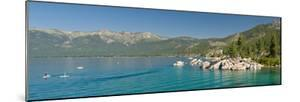 Stand-Up Paddle-Boarders Near Sand Harbor at Lake Tahoe, Nevada, USA