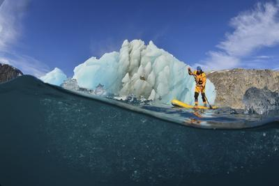 https://imgc.artprintimages.com/img/print/stand-up-paddle-boarding-by-an-iceberg-in-a-fjord-in-southeast-greenland_u-l-psvuxc0.jpg?p=0