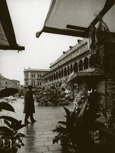 Stands and a Bookstall Keeper in Front of the Palazzo Della Ragione, in Padua-A^ Villani-Photographic Print