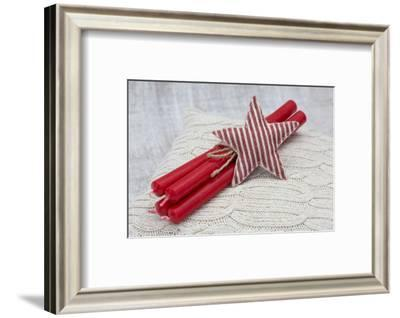 Star of Bethlehem and candles on cushion, still life-Andrea Haase-Framed Photographic Print