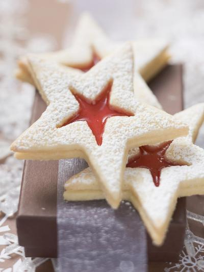 Star-Shaped Jam Biscuits with Icing Sugar (Christmas)--Photographic Print