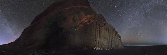 Starry sky and Winter Milky Way above basalt columns on the ocean coast.-Babak Tafreshi-Photographic Print