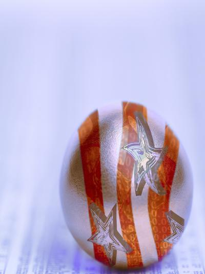 Stars and Stripes Golden Egg Resting on Financial Section of Newspaper--Photographic Print