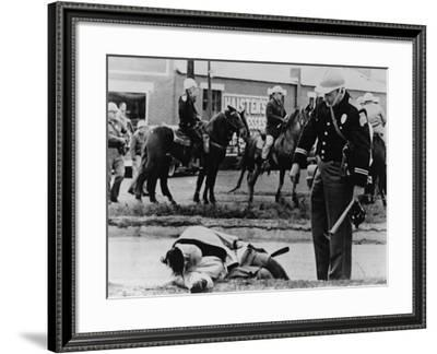 State Trooper Stands over an Injured Protester in Selma, Alabama, March 7, 1965--Framed Photo