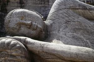 Statue Carved in Rock Depicting Sleeping Buddha