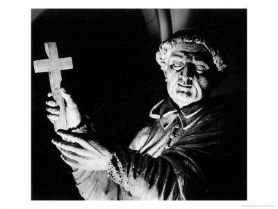 https://imgc.artprintimages.com/img/print/statue-of-a-priest-performing-an-exorcism-mortemer-abbey-normandy-france_u-l-p3fbti0.jpg?p=0