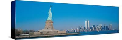 Statue of Liberty and Manhattan--Stretched Canvas Print