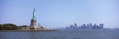 Statue of Liberty with Manhattan Skyline in the Background, Liberty Island, New York City, New Y...--Photographic Print