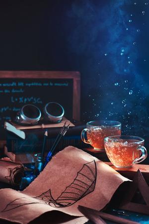 https://imgc.artprintimages.com/img/print/steampunk-tea-with-goggles-and-blueprints_u-l-q1fiwtb0.jpg?p=0