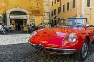 Alfa Romeo Duetto spider parked in a cobblestone street of Rome, Lazio, Italy by Stefano Politi Markovina