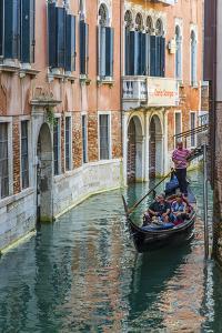 Gondola Boat Passing Through a Narrow Canal, Venice, Veneto, Italy by Stefano Politi Markovina
