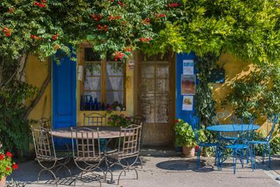 Ivy Surrounded House Front Door with Table and Chairs in Provence, France by Stefano Politi Markovina