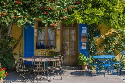 Ivy Surrounded House Front Door with Table and Chairs in Provence, France