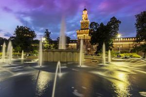 Twilight view of Sforza Castle or Castello Sforzesco and fountain, Milan, Lombardy, Italy by Stefano Politi Markovina