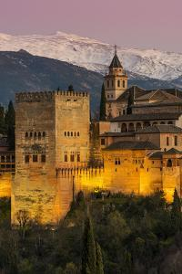 View at dusk of Alhambra palace with the snowy Sierra Nevada in the background, Granada, Andalusia, by Stefano Politi Markovina