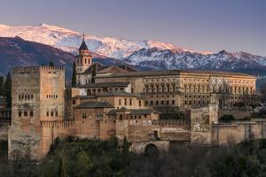 View at sunset of Alhambra palace with the snowy Sierra Nevada in the background, Granada, Andalusi by Stefano Politi Markovina