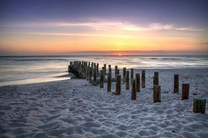 Ruins of the Old Naples Pier at Sunset on the Ocean by steffstarr