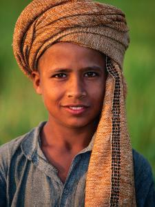 Boy with Orange Turban, Looking at Camera, Afghanistan by Stephane Victor