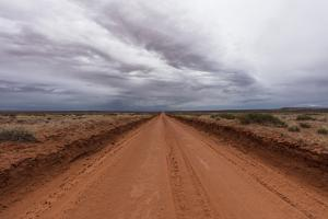 A Red Dirt Road and Cloudy Sky by Stephen Alvarez