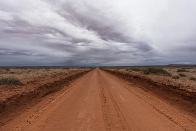A Red Dirt Road and Cloudy Sky