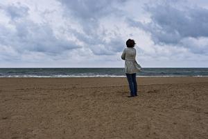 April Alvarez Looks Out at the Stormy Atlantic Ocean by Stephen Alvarez