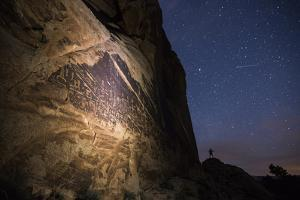 figures of the Butler Wash Panel under a starry sky. by Stephen Alvarez
